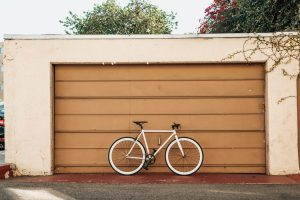 a bicycle in front of a garage