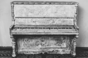antique piano that will be moved by piano movers Massachusetts