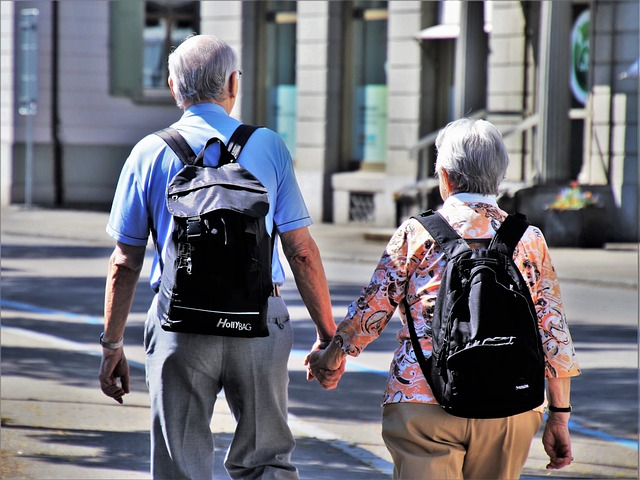 Two senior people holding hands