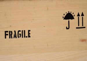 'Fragile' imprint on wooden crate - packing comes extra when it comes to moving costs Massachusetts.