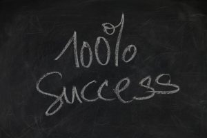 """100% success"" written on a blackboard"