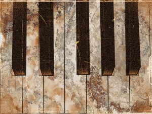 Decaying piano keys, ready for junk piano removal
