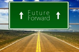 "A ""Future Forward"" sign above an empty road"
