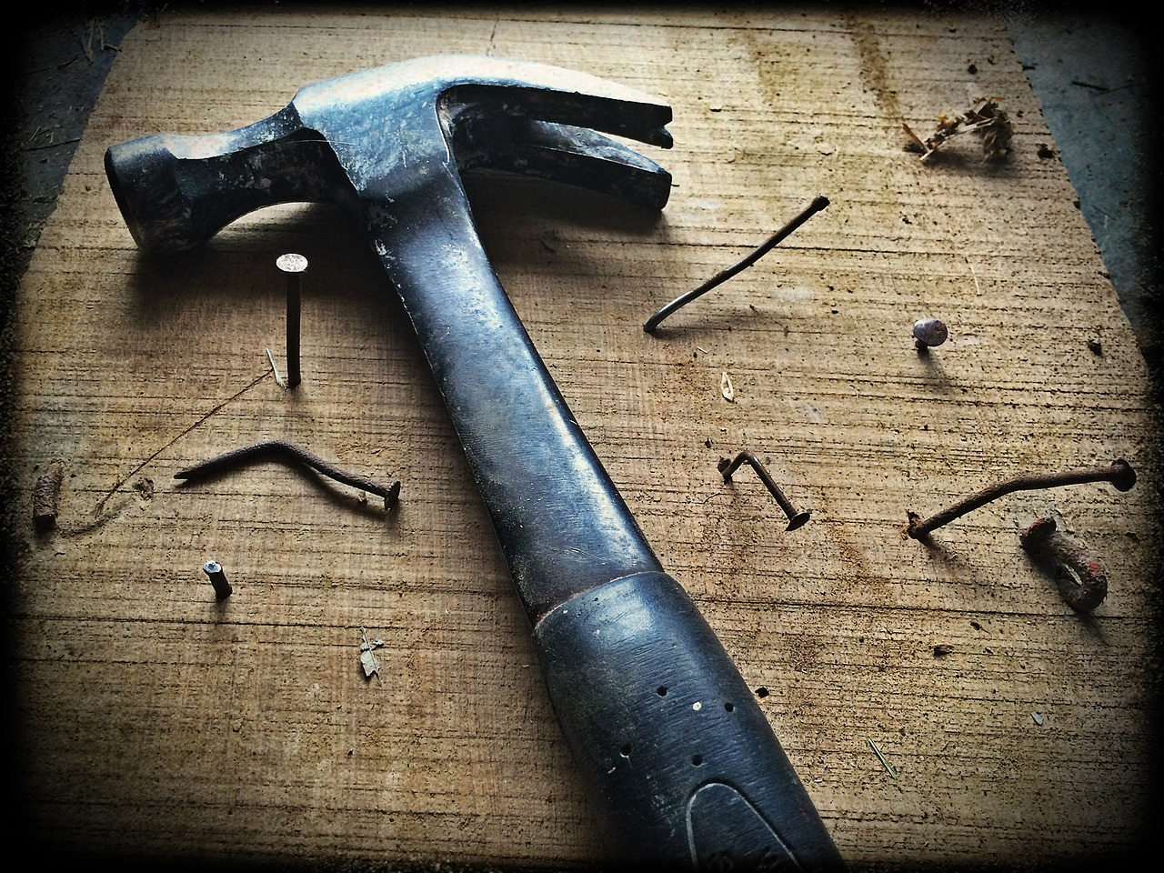 A hammer and deformed nails