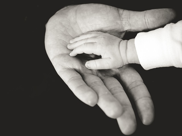 A man holding a child's hand.