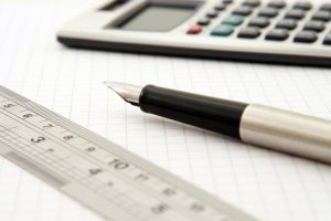 Paper, pen and calculator, helping you calculate your binding moving estimate