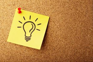 Post-it note with a light bulb.