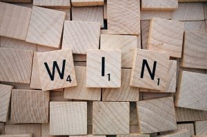 Wood squares made the word - win