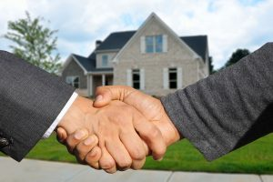two hands shaking as agreement to add value to your home