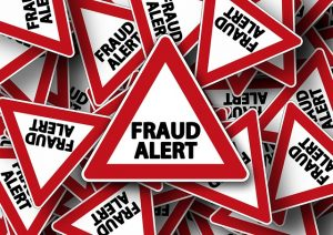 Professional movers' traits - fraud alert street sign