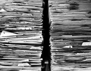 Piles of paperwork, if you have these in your office it is one of many sings that you need decluttering