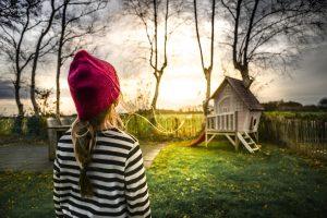 A girl in a yard.