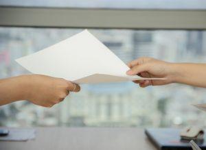 handing the paper
