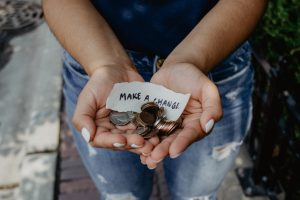 a girl holding coins