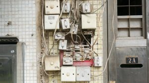 several power switches mounted on a wall