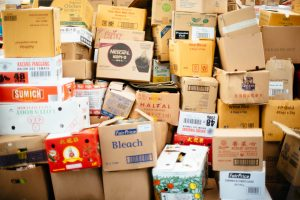 piled up cardboard boxes which help recognize a hoarder